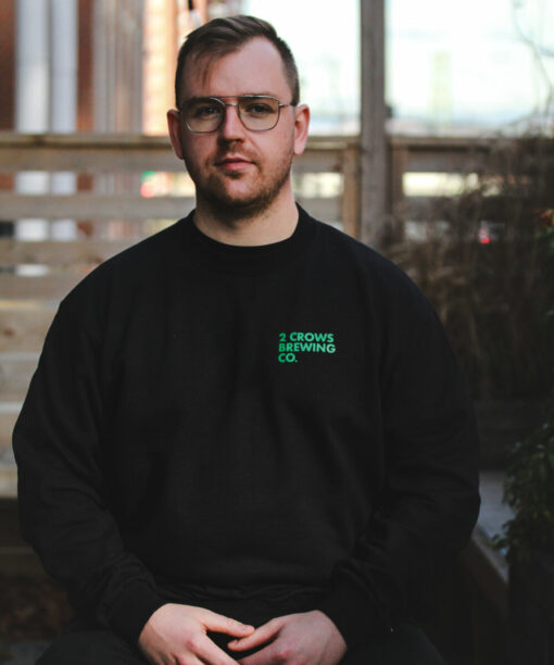 Black and green crew neck sweater